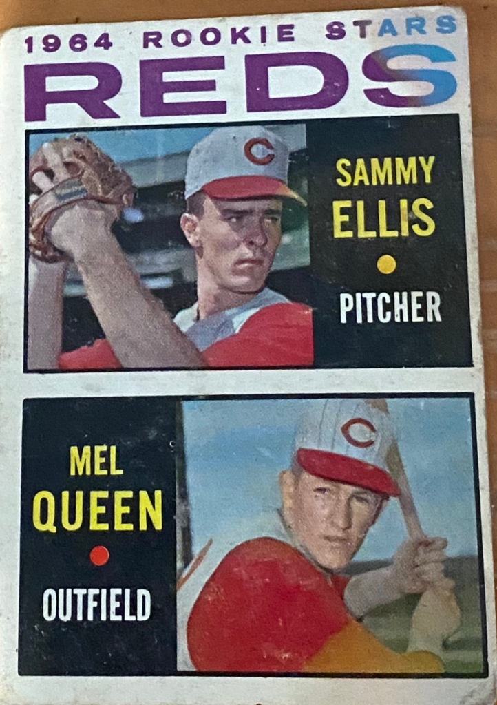Mel Queen got second billing on the rookie card he shared with Sammy Ellis, which seems fair given their impact on the 1964 pennant race. Ellis was 10-3 with 14 saves and 125 strikeouts in 122.1 innings. Queen batted .200 with two homers and 12 RBIs. His second homer, though, was a game-winner -- a three-run pinch-homer off Bob Gibson to break a 3-3 tie and give the Reds a 6-5 win on August 1. Ellis saved it, entering with the bases loaded and one out in the seventh and walking in the Cardinals' final run. He then fanned MVP Ken Boyer and got Bill White on a flyout, and got the final six outs while allowing just one hit. As for Queen's pitching career, he was part of a remarkable duel on September 1, 1967 against Hall of Famer Gaylord Perry and the Giants. Queen fanned 10, walked one and allowed eight hits in 9.1 scoreless innings. But that wasn't even half the game. Perry pitched 16 scoreless innings, allowing 10 hits, walking two and fanning 12. He left to a no-decision. The game remained scoreless for 20 innings, until the Reds' fourth and final pitcher Bob Lee, walked Dick Groat, after intentionally walking the .218 hitting Hal Lanier to load the bases with one out, to force in a run. Intentionally walking Lanier will never make sense. Frank Linzy, the only Giant to pitch other than Perry, retired the Reds in order to finish off a 1-0, 21-inning Giants win that featured only six pitchers. Giants catcher Tom Haller was 0-9 and teammate Willie McCovey 0-8 with four strikeouts; the Reds Tommy Harper was also 0-8. Queen was 1-3 at bat with a double off Perry. Maybe he wasn't such a bad hitter after all.